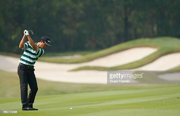 Wen Chong Liang of China plays his approach shot on the sixth hole during the second round of the Omega Mission Hills World Cup at the Mission Hills...