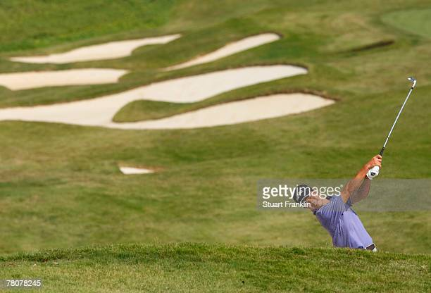 Wen Chong Liang of China plays his bunker shot on the nineth hole during the third round of the Omega Mission Hills World Cup at the Mission Hills...
