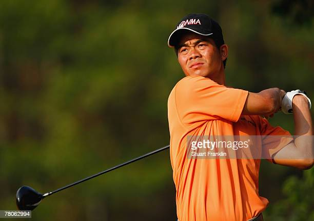 Wen Chong Liang of China plays his tee shot on the 16th hole during the first round of the Omega Mission Hills World Cup at the Mission Hills Golf...