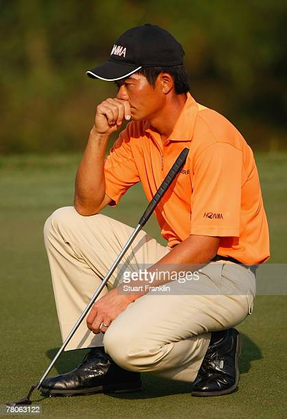 Wen Chong Liang of China ponders a putt on the 15th hole during the first round of the Omega Mission Hills World Cup at the Mission Hills Golf Resort...