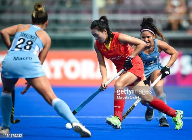 Wen Dan of China competes for the ball with Julieta Jankunas of Argentina during the Women's FIH Field Hockey Pro League match between Argentina and...