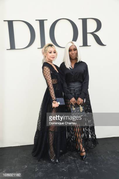 Wen Ji and Jackie Aina attend the Christian Dior show as part of the Paris Fashion Week Womenswear Spring/Summer 2019 on September 24 2018 in Paris...
