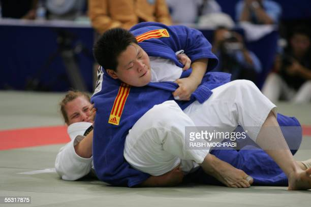 Wen Tong of China fights with Britain's Karina Bryant during the final of 78kg women class at the World Judo Championships in Cairo 08 September 2005...
