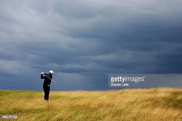 WenChong Liang of China hits his approach shot on the 9th hole during round two of the 138th Open Championship on the Ailsa Course Turnberry Golf...