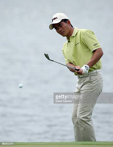Wenchong Liang of China hits his third shot at the 10th hole during the first round of the 2008 World Golf Championships CA Championship at the Doral...