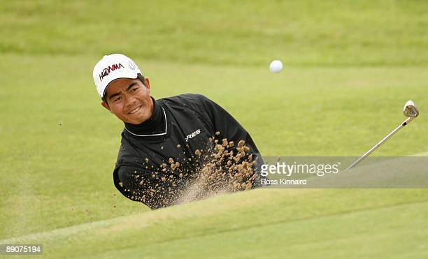 WenChong Liang of China hits out of a bunker during round two of the 138th Open Championship on the Ailsa Course Turnberry Golf Club on July 17 2009...