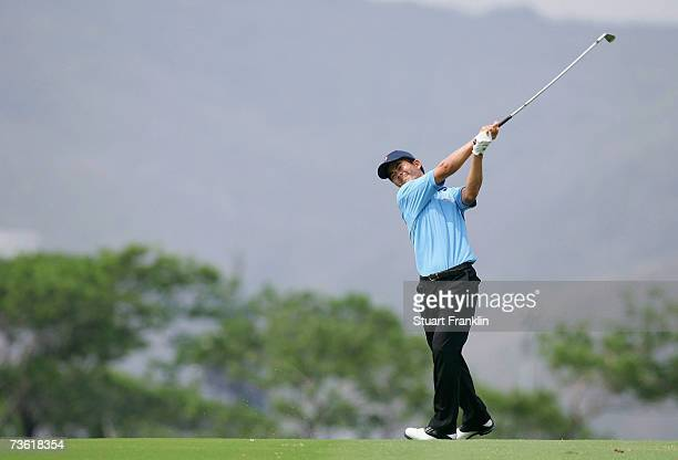 WenChong Liang of China plays his approach shot on the second hole during the third round of The TCL Classic at Yalong Bay Golf Club on March 17 2007...