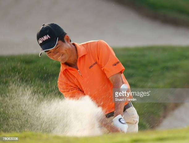 WenChong Liang of China plays his bunker shot on the 15th hole during the first round of the Omega Mission Hills World Cup at the Mission Hills Golf...