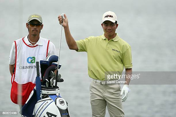 Wenchong Liang of China prepares to hit his third shot at the 10th hole during the first round of the 2008 World Golf Championships CA Championship...