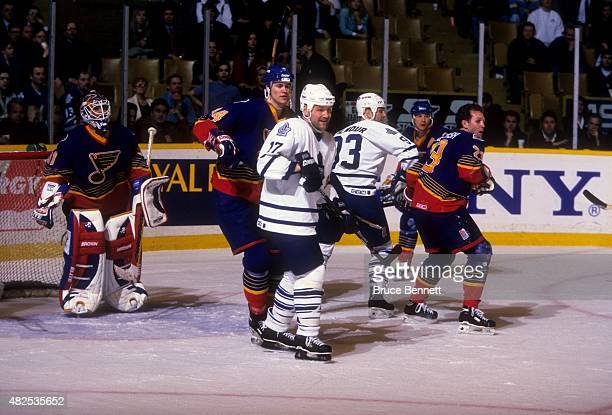 Wendel Clark and Doug Gilmour of the Toronto Maple Leafs battle with Chris Pronger Craig MacTavish and goalie Grant Fuhr of the St Louis Blues during...