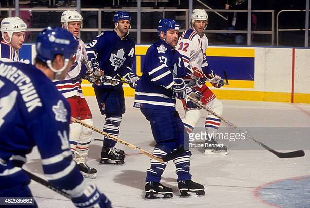 Wendel Clark and Doug Gilmour of the Toronto Maple Leafs wait for the shot as Brian Leetch and Stephane Matteau of the New York Rangers defend on...
