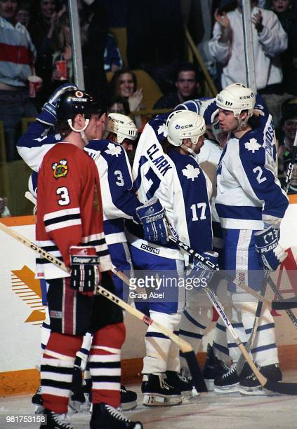 Wendel Clark and Luke Richardson of the Toronto Maple Leafs celebrate a goal against Dave Manson of the Chicago Black Hawks during NHL game action on...