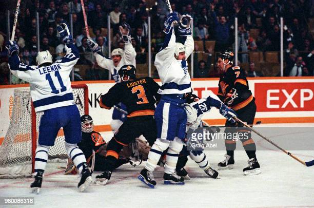 Wendel Clark Gary Leeman Ed Olczyk and Daniel Marois of the the Toronto Maple Leafs skate against Barry Pederson Doug Lister and Steve Weeks of the...