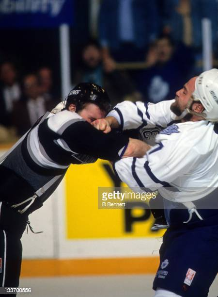 Wendel Clark of the Toronto Maple Leafs fights with Marty McSorley of the Los Angeles Kings circa 1993 at the Maple Leaf Gardens in Toronto, Ontario,...