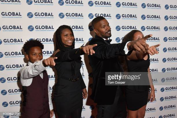 Wendel Hutchins II Aaniya Hutchins Jamie Foxx and Analise Foxx on the red carpet at the Global Down Syndrome 10th anniversary BBBY fashion show at...