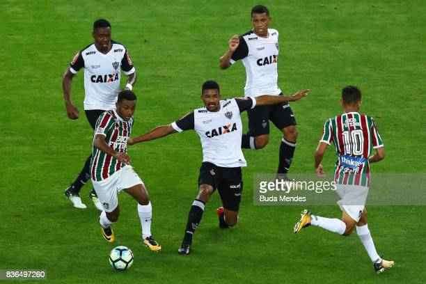 Wendel of Fluminense struggles for the ball with a players of Atletico MG during a match between Fluminense and Atletico MG part of Brasileirao...