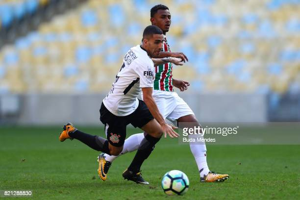 Wendel of Fluminense struggles for the ball with Gabriel of Corinthians during a match between Fluminense and Corinthians as part of Brasileirao...