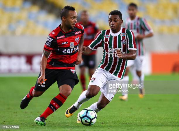 Wendel of Fluminense struggles for the ball with Niltinho of Atletico GO during a match between Fluminense and Atletico GO as part of Brasileirao...