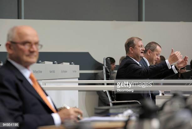 Wendelin Wiedeking chief executive officer of Porsche SE center gestures while speaking as Ferdinand Piech chairman of Volkswagen AG left listens at...
