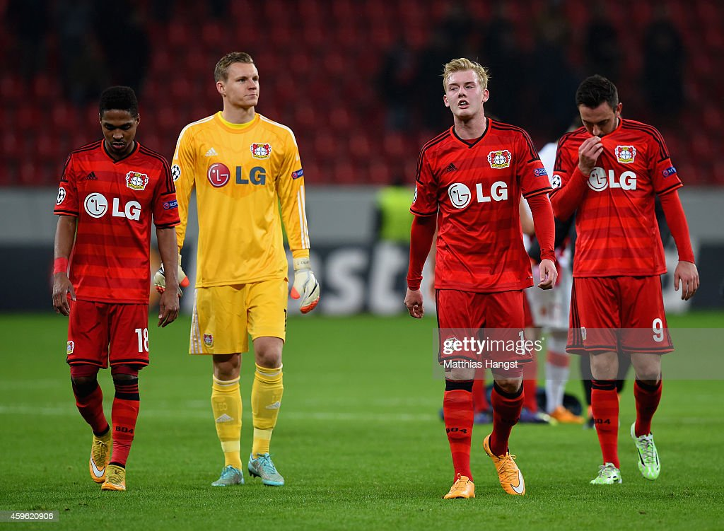 Wendell , Bernd Leno, Julian Brandt and Josip Drmic of Bayer Leverkusen walk off th pitch dejected after the UEFA Champions League group C match between Bayer 04 Leverkusen and AS Monaco FC at BayArena on November 26, 2014 in Leverkusen, Germany.