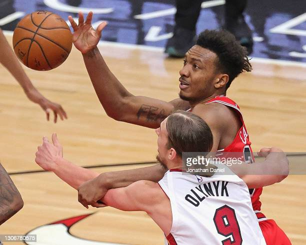 Wendell Carter Jr. #34 of the Chicago Bulls battles for a loose ball with Kelly Olynyk of the Miami Heat at the United Center on March 12, 2021 in...
