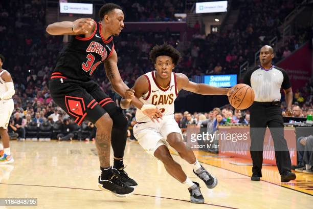 Wendell Carter Jr #34 of the Chicago Bulls guards Collin Sexton of the Cleveland Cavaliers during the first half at Rocket Mortgage Fieldhouse on...
