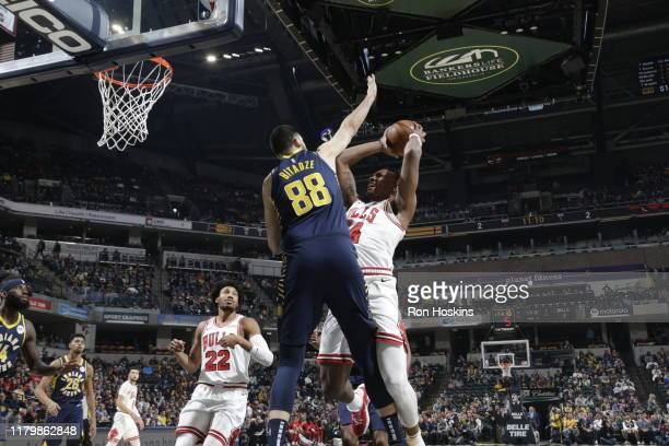 Wendell Carter Jr #34 of the Chicago Bulls shoots the ball against Goga Bitadze of the Indiana Pacers on November 3 2019 at Bankers Life Fieldhouse...
