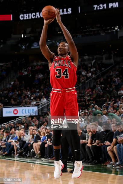 Wendell Carter Jr #34 of the Chicago Bulls shoots the ball against the Milwaukee Bucks during a preseason game on October 3 2018 at Fiserv Forum in...
