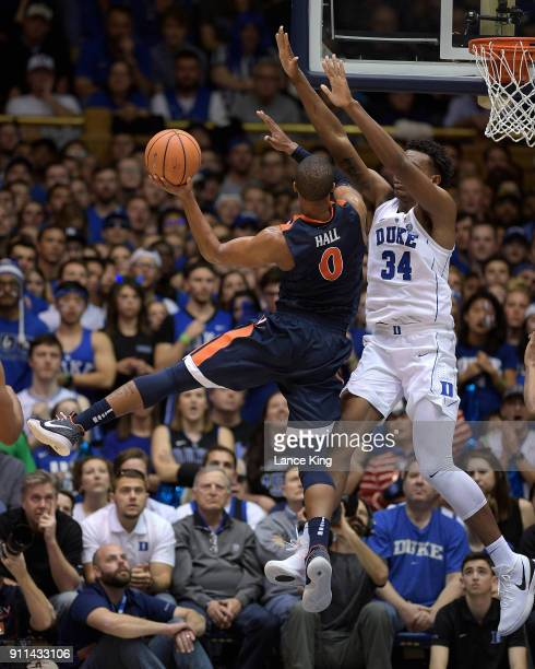 Wendell Carter Jr #34 of the Duke Blue Devils defends a shot by Devon Hall of the Virginia Cavaliers at Cameron Indoor Stadium on January 27 2018 in...