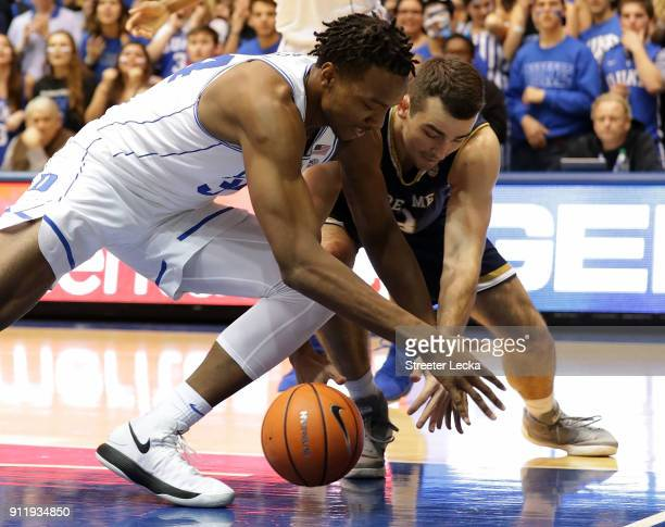 Wendell Carter Jr #34 of the Duke Blue Devils goes after a loose ball against John Mooney of the Notre Dame Fighting Irish during their game at...