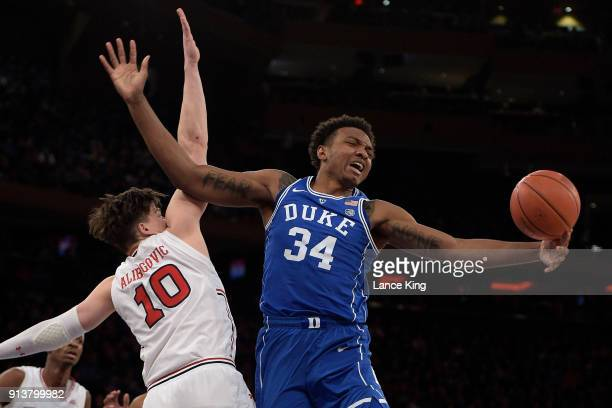 Wendell Carter Jr #34 of the Duke Blue Devils reaches for the ball against Amar Alibegovic of the St John's Red Storm at Madison Square Garden on...