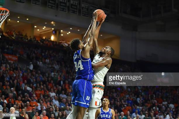 Wendell Carter Jr of the Duke Blue Devils blocks a shot attempt by Dewan Huell of the Miami Hurricanes during the second half of the game at The...