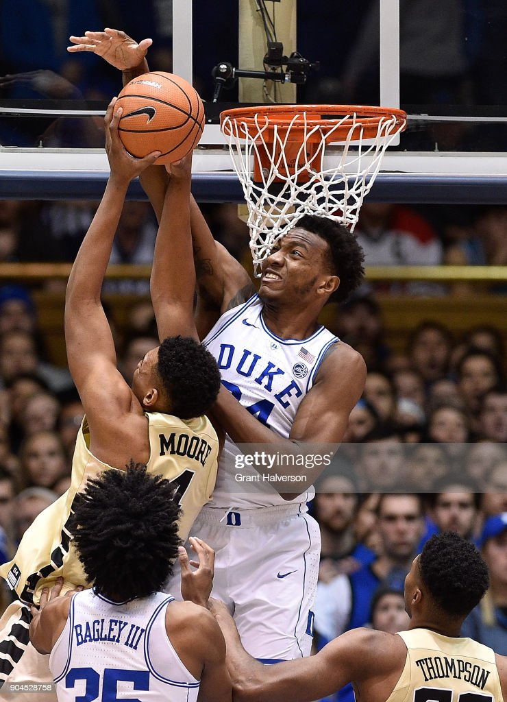 Wendell Carter Jr #34 of the Duke Blue Devils blocks a shot by Doral Moore #4 of the Wake Forest Demon Deacons during their game at Cameron Indoor Stadium on January 13, 2018 in Durham, North Carolina.