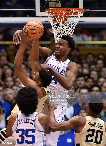 Wendell Carter Jr of the Duke Blue Devils blocks a shot by Doral Moore of the Wake Forest Demon Deacons during their game at Cameron Indoor Stadium...
