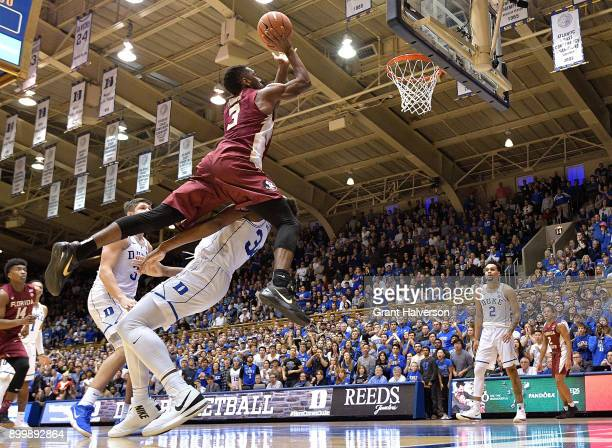 Wendell Carter Jr of the Duke Blue Devils draaws a charging foul against Trent Forrest of the Florida State Seminoles during the closing minute of...