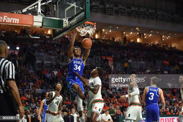 Wendell Carter Jr of the Duke Blue Devils dunks the basketball over Anthony Lawrence II of the Miami Hurricanes during the first half of the game at...