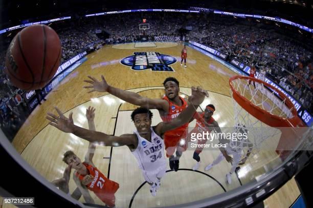 Wendell Carter Jr of the Duke Blue Devils looks for the rebound against Oshae Brissett of the Syracuse Orange in the 2018 NCAA Men's Basketball...