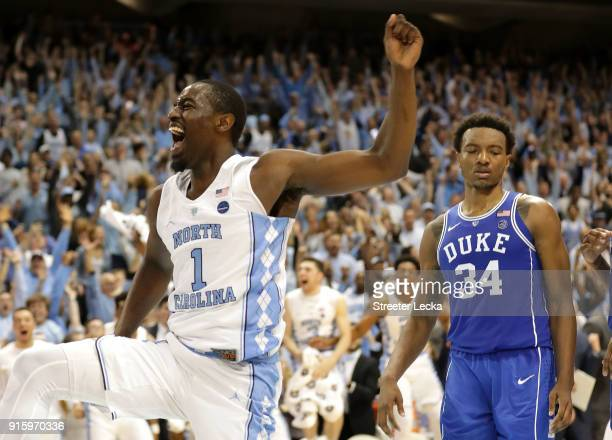 Wendell Carter Jr of the Duke Blue Devils watches as Theo Pinson of the North Carolina Tar Heels reacts after a dunk during their game at Dean Smith...