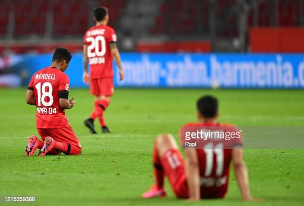 Wendell, Charles Aranguiz und Nadiem Amiri of Leverkusen react at full time during the Bundesliga match between Bayer 04 Leverkusen and VfL Wolfsburg...