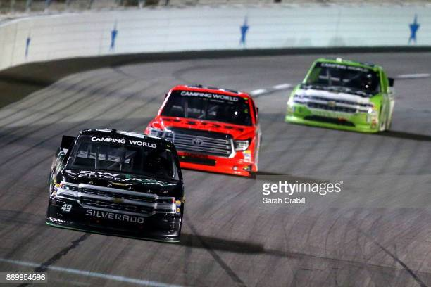 Wendell Chavous driver of the Low T Center Chevrolet leads a pack of cars during the NASCAR Camping World Truck Series JAG Metals 350 Driving...