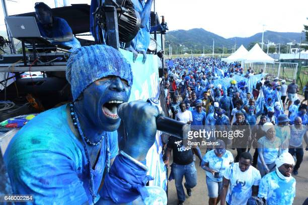 Wendell Manwarren of the Rapso music band 3canal takes part in J'ouvert during the 20th anniversary celebration of their song Blue as part of...