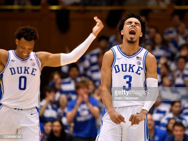 Wendell Moore Jr #0 and Tre Jones of the Duke Blue Devils react during the second half of their game against the North Carolina State Wolfpack at...