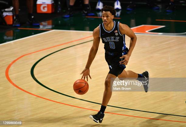 Wendell Moore Jr. #0 of the Duke Blue Devils brings the ball up the court against the Miami Hurricanes during the first half at Watsco Center on...