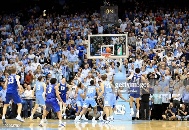 Wendell Moore Jr #0 of the Duke Blue Devils makes the game winning shot to defeat the North Carolina Tar Heels 9896 during their game at Dean Smith...