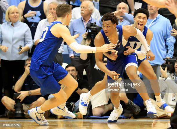 Wendell Moore Jr. #0 of the Duke Blue Devils reacts after making the game winning shot to defeat the North Carolina Tar Heels 98-96 with teammates...