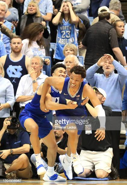Wendell Moore Jr. #0 of the Duke Blue Devils reacts after making the game winning shot to defeat the North Carolina Tar Heels 98-96 with teammate...
