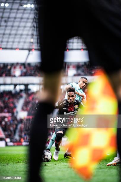Wendell Nascimento Borges of Leverkusen and Robin Quaison of Mainz fight for the ball during the Bundesliga match between Bayer 04 Leverkusen and 1....