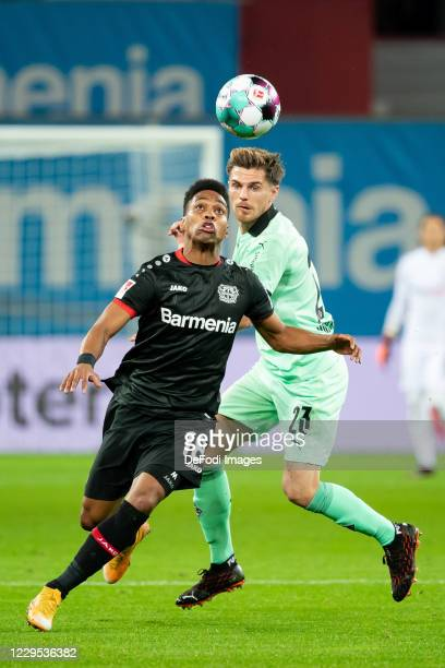 Wendell of Bayer 04 Leverkusen and Jonas Hofmann of Borussia Moenchengladbach battle for the ball during the Bundesliga match between Bayer 04...