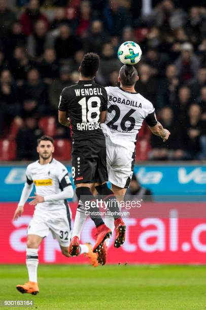Wendell of Bayer 04 Leverkusen and Raul Bobadilla of Borussia Moenchengladbach battle for the ball during the Bundesliga match between Bayer 04...