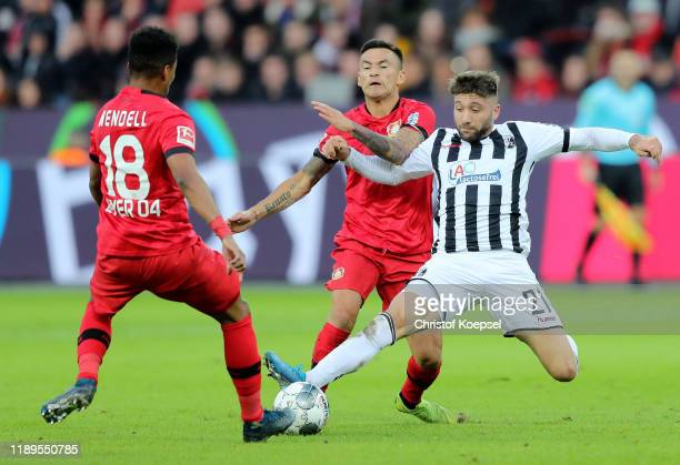 Wendell of Bayer 04 Leverkusen battles for possession with Brandon Borrello of SportClub Freiburg during the Bundesliga match between Bayer 04...